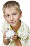 Boy with big piggy bank. Eight years old boy with big piggy bank isolated on white Royalty Free Stock Photos