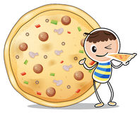 A boy beside a big pizza Royalty Free Stock Images
