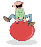 Boy in big red jumping ball Stock Photos