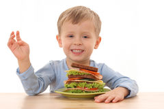 Boy and big sandwich Royalty Free Stock Photos
