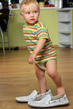 Boy  in big shoes Royalty Free Stock Photos
