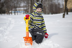 Boy with big shovel to clear snow Royalty Free Stock Images