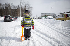 Boy with big shovel to clear snow Stock Images