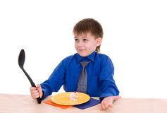Boy with a big spoon Royalty Free Stock Photo