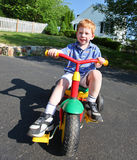 Boy on bike. Happy young boy playing outside on a bike Stock Images