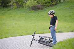 Boy and bike Stock Image