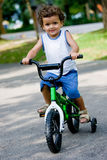 Boy On Bike. A young boy on his first bike in the park stock images
