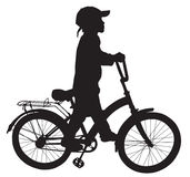 Boy on bike04. Boy goes for a walk with the bike Royalty Free Stock Images