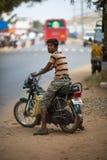 Boy on bike Stock Photos