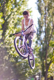 Boy on bike make the barspin trick Royalty Free Stock Photography