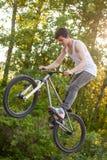 Boy on bike make the bunny hop trick.  royalty free stock photography