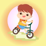 Boy on bike Mascot cartoon great for any use. Vector EPS10. Royalty Free Stock Image