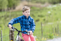 Boy on a bike Royalty Free Stock Photos