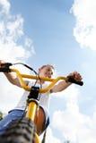 Boy on a bike outside Stock Photography