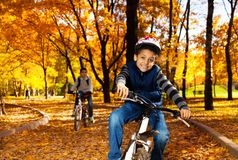 Boy on bike ride with brother Stock Photos