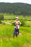 Boy on bike rides Stock Photo