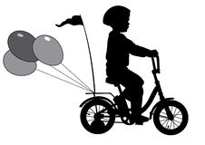 Boy on bike02. A boy rides a bicycle with balloons Stock Image
