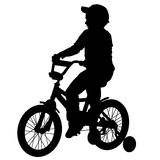 Boy on bike05. A boy rides a bicycle on a walk Royalty Free Stock Images