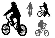Boy on bike. A boy rides a bicycle on a walk Stock Images