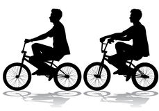 Boy on bike. A boy rides a bicycle on a walk Royalty Free Stock Photos