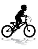 Boy on bike. A boy rides a bicycle on a walk Stock Photo