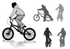 Boy on bike. A boy rides a bicycle on a walk Stock Image