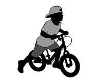 Boy on bike. The boy sits on the bike. Walk on the bike Stock Images