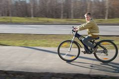 Boy on the bike. Boy ten years of age on the bike in spring looks to the camera and rides Royalty Free Stock Images
