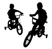 Boy on bike08. Two boys riding bikes on the promenade. Walk in the Park Royalty Free Stock Photography