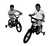 Boy on bike Stock Photography