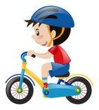 Boy on bike wearing blue helmet Stock Photo