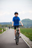 Boy biking Stock Photography
