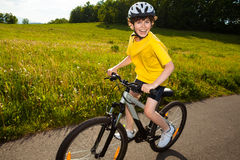Boy biking Stock Photos