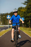 Boy biking Royalty Free Stock Photos