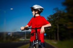 Boy biking Stock Image