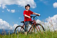 Boy biking Royalty Free Stock Photo