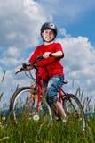 Boy biking Stock Images