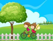 A boy biking with his girlfriend Stock Images