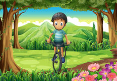 A boy biking at the jungle Stock Photo