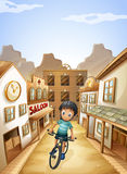 A boy biking in the middle of the saloon bars Stock Images