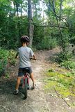 Boy biking on a trail stock photography