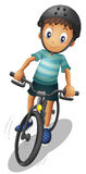 A boy biking wearing a helmet Stock Image