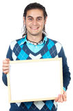 Boy with billboard. Casual boy with billboard a over whie background royalty free stock photos