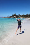 Boy at Binalong Bay - Bay of Fires - Tasmania Australia. A boy jumping at the beach at Binalong Bay - Tasmania. This east coast area of Tasmania is home to some Royalty Free Stock Photos