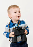 Boy with binocular Stock Photos