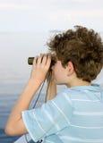 Boy binoculars Stock Photo