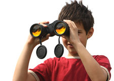 A boy with binoculars. A boy looking trough a binoculars isolated on a white background Royalty Free Stock Image