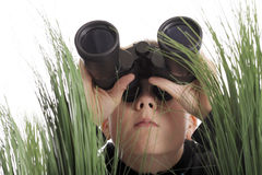 Boy with binoculars Stock Photo