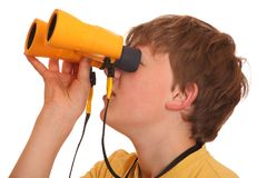 Boy with binoculars Stock Images