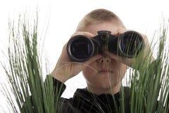Boy with binoculars Stock Photos